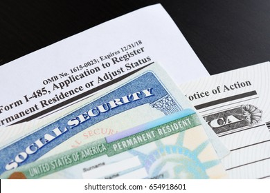 U.S.A. green card and social security number.