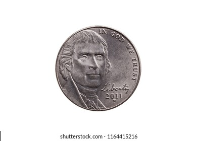 USA half dime nickel coin (25 cents) with a portrait image of Thomas Jefferson cut out and isolated on a white background