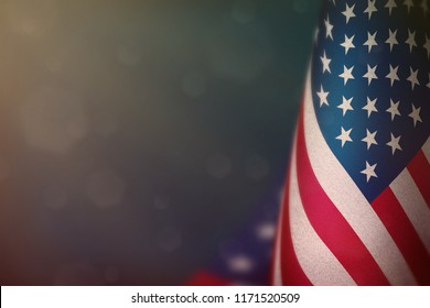 USA hanging flag for honour of veterans day or memorial day on light blue dark velvet background. USA glory to the heroes of war concept.