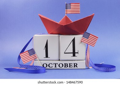 USA holiday, Happy Columbus Day, for the second Monday in October, 14 October, celebration Save the Date calendar with a red paper boat and stars and strips flags and ribbons decorations.