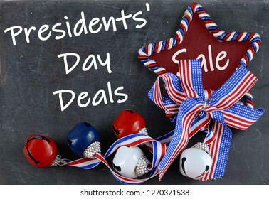 USA holiday image of red white and blue star shape and jingle bells with matchiing ribbon on worn slate background. Presidents' Day sale message added