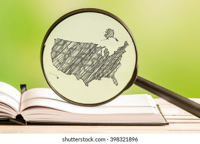 USA information with a pencil drawing of an america map in a magnifying glass