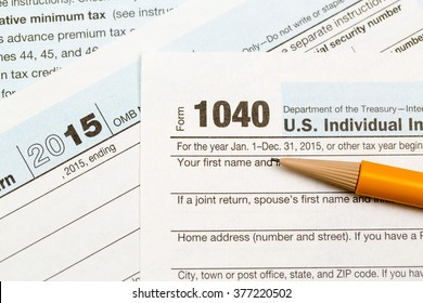 USA IRS tax form 1040 for year 2015 with pencil and taken from above