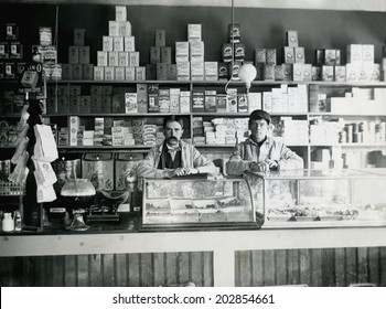 USA - KANSAS - CIRCA 1890 An old vintage photo of an early grocery store stocked with goods. The male store owner and employee are behind the counter. This photo is from the Victorian era. CIRCA 1890