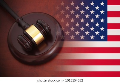 usa law concept, wooden gavel on table and flag of United States