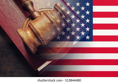 usa legal concept, judge wooden gavel and legal book with usa flag