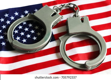 Usa legal system concept, handcuffs on money background and american flag
