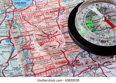 USA map with the city of Indianapolis and a compass with magnifying glass over Indianapolis.