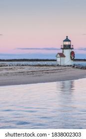 USA, Massachusetts, Nantucket Island. Nantucket Town, Brant Point Lighthouse with a Christmas wreath at dusk.