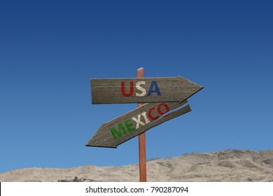 USA to Mexico sign on desert background