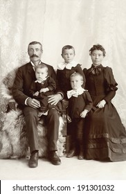 USA - MINNESOTA - CIRCA 1895 A vintage photo of a Victorian family. The parents are sitting with three small children. The father has a mustache. This photo is from the Victorian era. CIRCA 1895