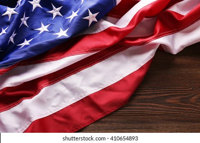 USA national flag on wooden background, close up