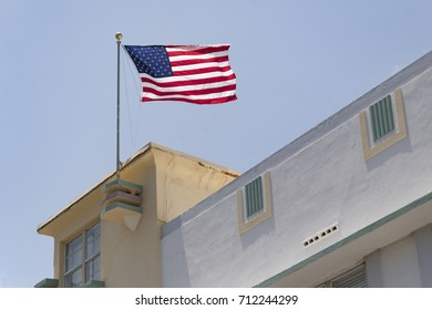 U.S.A National flag waving flying in the art deco architectural district in daytime  The flag of the United States of America  is the national flag of the United States.