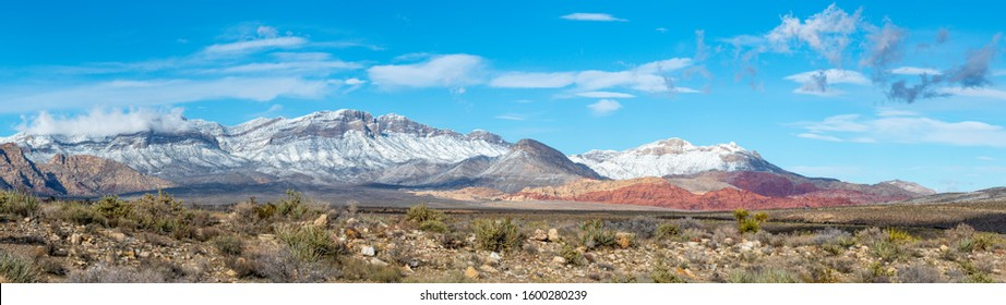 USA, Nevada, Clark County, Red Rock Canyon National Conservation Area. A panoroama of Snow covering the mountains above this famous hiking area outside Las Vegas