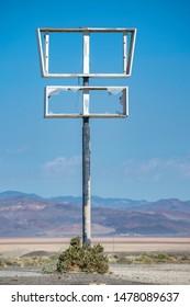 USA, Nevada, Esmeralda County, Coaldale Ghost Town. Broken Blank Post-Apocalyptic Sign Post
