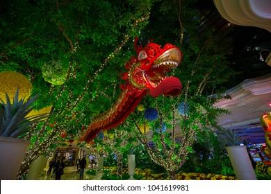 USA. NEVADA. LAS VEGAS. MARCH 2018: Hall / Lobby Hotel Wynn in Las Vegas. Flowers - plants decoration. Chinese Red dragon.