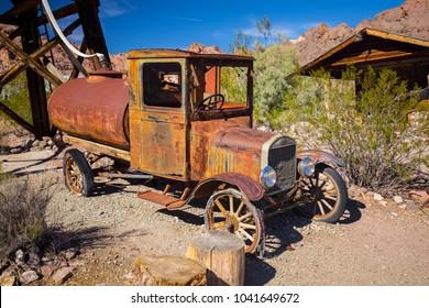 USA. NEVADA. NELSON. SEARCHLIGHT. MARCH 2018: Eldorado Canyon Mine Tours. Many Old cars. Cinematographic place. Abandoned village.