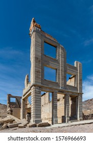 USA, Nevada, Nye County, Bullfrog Hills, Rhyolite Ghost Town. The remains of a crumbling three story stone bank building,