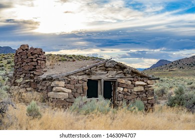 USA, Nevada, Nye County, Grant Range. Sunset over Callaway Well stone cabin along the Pony Express Route and Overland Stage Line. Red Mountain is visible in the background right.