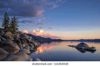 USA, Nevada, Washoe County, Sand Harbor State Park: Sand Point with pine trees and granite boulders along the shore and peaking out as islands in picturesque Lake Tahoe.