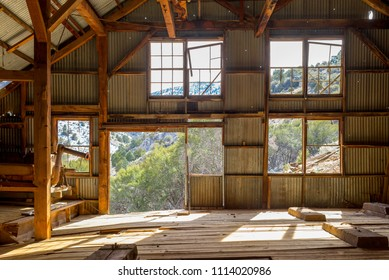 USA, Nevada, White Pine County: Bright mountain light shines through large picture windows inside Belmont Mill.