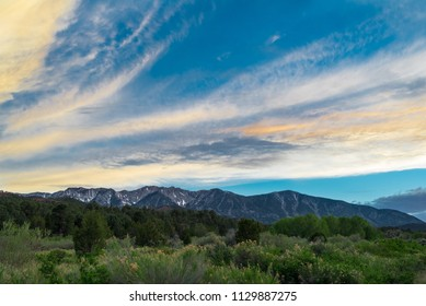 USA, Nevada, White Pine County, White Pine Range. The sun sets behind the mountains.