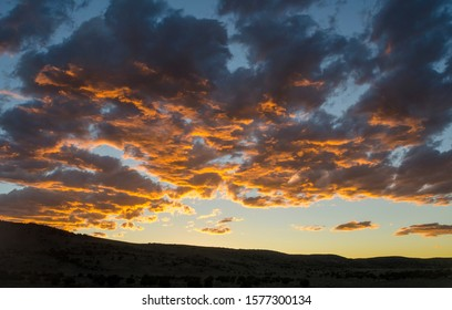 USA, Nevada, White Pine County, Nye County, Duckwater Valley. A firey sunset western background scene with strong blue orange color contrast.