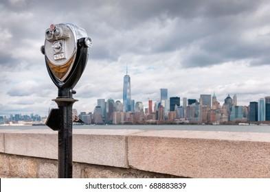 USA, New Jersey, View on Manhattan skyline from Ellis Island, Binoculars in foreground