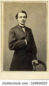 USA - NEW YORK - CIRCA 1863 - A vintage Cartes de visite photo of a young gentleman. The man is standing with one arm inserted into his coat. A photo from the Civil War era. CIRCA 1863