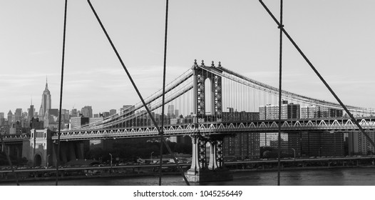 USA New York City Bridge Black White - Lines, concrete and metal being materials used to construct modern infrastructure and today's showpieces of industrial/architectural achievement