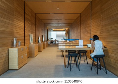 USA, New York – June 2018: The interior design of the co-working space. Coworker Manager working on a laptop.
