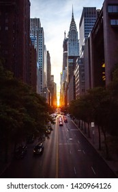 USA, New York June 2019: Sunset over 42nd Street with the colorful lights of traffic through Midtown Manhattan, New York City NYC