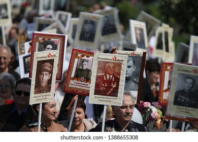 USA, New York, May 2019: People during the procession of the immortal regiment in New York, USA with portraits of their grandfathers and grandmothers who died during World War II.