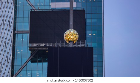 USA, New York, Times Square. May 2, 2019. Colorful crystal new years eve ball and black blank billboards on glass skysraper facade background.