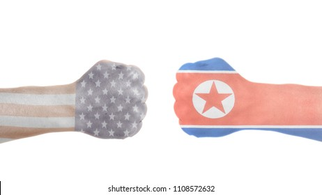 USA and North Korea flags painted on two clenched fists.USA vs North Korea concept.