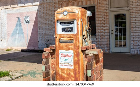 USA Oklahoma, May 13th, 2019. Rusty vintage fuel pump in an abandoned service station, sunny spring day near Amarillo. Historic route 66