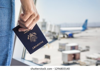 USA passport holder at airport. People traveling by air concept.