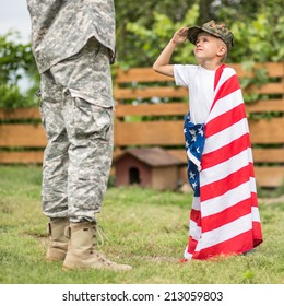 USA patriots concept. Son salutes his father. focus on son. daylight