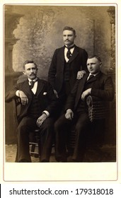 USA - PENNSYLVANIA - CIRCA 1890 A vintage Cabinet Card photo of three young men. Two of the men have mustaches. They are dressed in Victorian style clothing. Photo is from the Victorian era CIRCA 1890