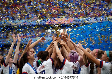 USA players celebrate after winning the 2019 FIFA Women's World Cup France Final match between The United State of America and The Netherlands at Stade de Lyon on July 7, 2019 in Lyon, France.