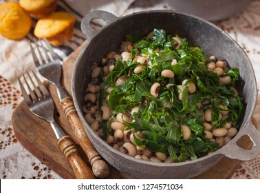 USA Southern New Year's Day Dish of Collard Greens, Black Eyed Peas and Cornbread in a Rustic Pot