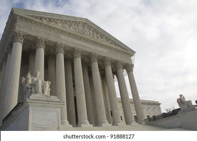 USA Supreme Court building in Washington, DC with a cloudy sky background.