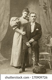 USA - TEXAS - CIRCA 1895 - A vintage photo of a young couple. The husband is sitting and the wife is standing. She is dressed in a Victorian style dress. A photo from the Victorian era. CIRCA 1895