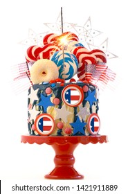 USA theme on-trend candyland fantasy drip cake with lollipops and candy decorations on white background.