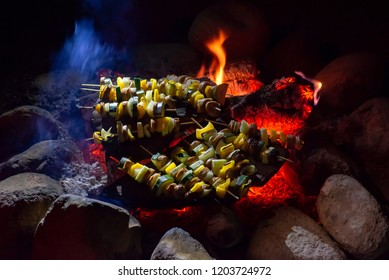 USA, Utah, San Juan County, Glen Canyon National Recreation Area. Kebab skewers made with sausage, onions, zuchinni, and yellow bell peppers. Cooked on natural stone slabs over an open campfire.