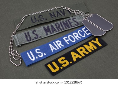 USA veteran concept with dog tags on olive green uniform background