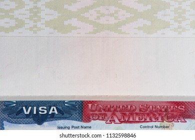USA visa in passport close-up. Passport with visa of United States of America and blank page.