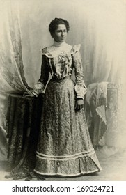 USA - WASHINGTON DC - CIRCA 1890 - A vintage antique photo of a young woman standing. The woman is dressed in a Victorian style dress. A photo from the Victorian era. CIRCA 1890