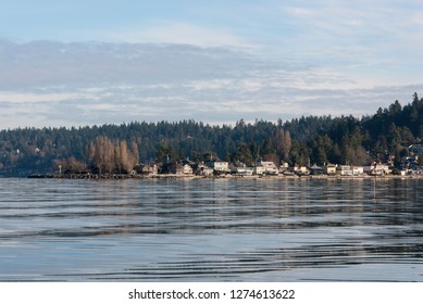 Usa, Washington State, Burien. Three Tree Point on flat calm morning