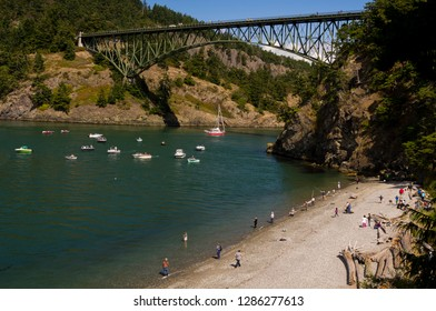 USA, Washington State, Deception Pass State Park. Salmon fishing in Deception Pass. Deception Pass bridge spans strait separating Whidbey Island from Fidalgo Island.